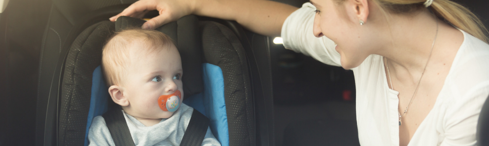 image of baby in car seat