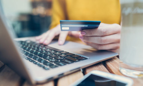 image of user using credit card and laptop